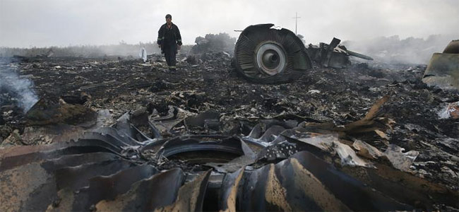 Малайзийские жертвы со сбитого в Украине лайнера MH17 возвращаются домой