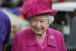 Britain's Queen Elizabeth II visits the prop-making workshop at the National Theatre in London, Tuesday Oct. 22, 2013 to commemorate the institution's 50th anniversary. (AP Photo/Lefteris Pitarakis, pool)